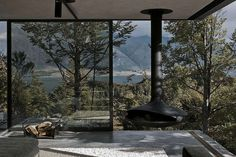 Rustic modern ceiling suspended fireplace on outdoor/indoor terrace
