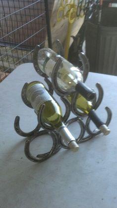 A 6 bottle horseshoe wine rack. Handmade of recycled horseshoes