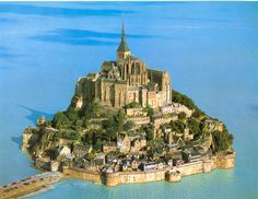 Saint-Michel Abbey is located on a tidal island in Normandy, North-West of France. It is one of the country's religious landmarks and it is situated one kilometer away (just over a half-mile) from the coast, within the Atlantic ocean.