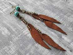 Bohemian Dangle Earrings. Long Dangle Earrings. Leather Feather Earrings. Gemstone Earrings. Boho Earrings. Bronze Gemstone Earrings. Materials: genuine leather,bronze jewelry findings,gemstone beads,bronze chain,bronze beads. Length with hooks: 14 cm (5.75) Stone beads: 1 Turquoise 2