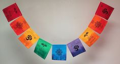 "Tibetan Buddha Eyes Om Mani Padme Hum prayer flags. Flags have a quote from the Dalai Lama. Buddha eyes, OM MANI PADME HUM (""The jewel in the heart of the lotus""), and the 8-spoked wheel of samsara. This prayer flag has a lotus flower and the quote, ""Lotus flower, growing from the mud and blooming toward the sky, resurrection, purity, awakening, revival."" And also the OM symbol with the quote, ""OM- the primordial sound by which the earth was created. The past, present, and future are all..."