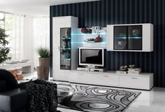 Set of white wall cabinets against a striped wall