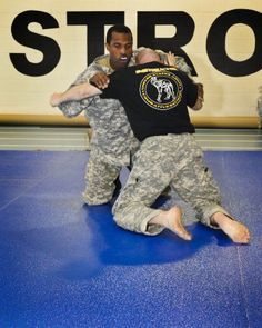 Soldiers of the Army Sustainment Command gathered and paired up on mats at the RIA Community Fitness Center, Oct. 1, for some of the most energetic schooling they are likely to ever receive.