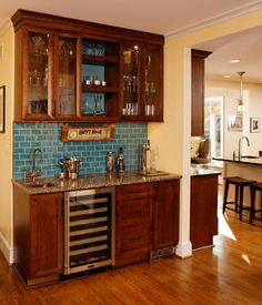 Marvelous mini kegerator in Kitchen Eclectic with Basement Wet Bar next to Wet Bar Wine Refrigerator alongside Turquoise Backsplash and Kegerator