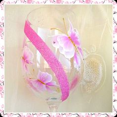 This large wine glass has been painted with pretty pink butterflies.   swarovski , Austrian crystals and glitters add a beautiful shimmer to the glass.