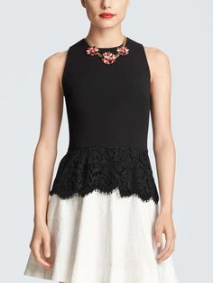 Flirty, feminine and a little bit sparkly, this fitted shell is finished with a sweet lace peplum.
