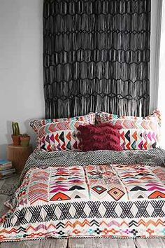 Great colorful geometric quilt!