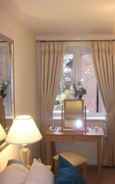 hang curtains above the window, not in the window. Makes the window bigger.