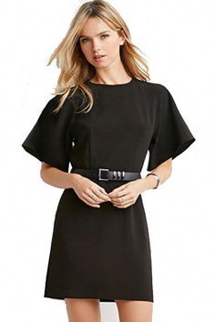 3f8c0d67ca928 Give It Some Edge - This black dress delivers a punch of drama on the  sleeves