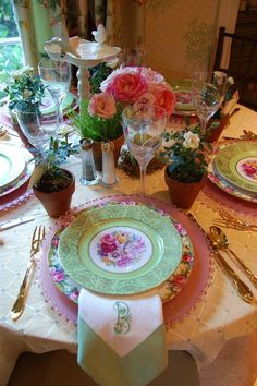 For a garden inspired tea party I utilized her gorgeous collection of china and beautifully monogrammed linen napkins,  a delicate ivory bird bath along with bouqueted pink garden roses and potted wheatgrass finished this tea party look.