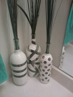 A great way to re-use your wine bottles. I simple just tape off the design I want and then spray paint. Let the paint dry and feel of the paint for a nice decorative vase!! If I need to touch up I just use a Q-tip and nail polish remover!!! So simple and cheap...I even made 50 of them for a friends wedding centerpieces...Just ask your friends, family or local bars/winery's to save bottles!!!
