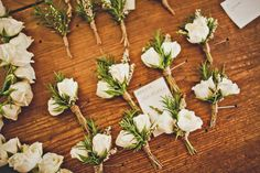The boutonnieres will be cream spray roses and green lamb's ear wrapped in raffia with the stems showing.
