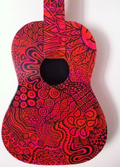 Painted guitar! I have an old guitar in the garage that I've been meaning to paint and use as a decoration. I love this black on color design idea,