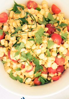 Sweet corn and tomatoes are two summer staples, and they're even brighter together with fresh herbs, and a dash of lime juice and Dijon mustard.