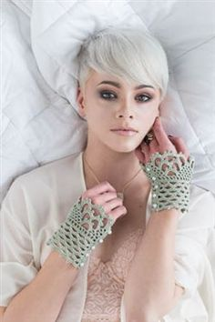 """Go There Now Add feminine flair with these delightful lace cuffs. Wear them with a sleeveless dress or let them peek from the cuffs of a long-sleeve top. (Or work them in a wool yarn for winter!) DESIGNER Alla Koval FINISHED SIZE 7 1/2 (8 1/4, 9)"""" wide and 4 1/2″ long. YARN Omega Cotton…"""
