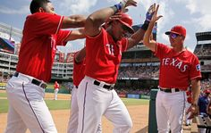 Rangers congratulate Texas Rangers Adrian Beltre after he scored a home run during the second inning against the Houston Astros Saturday, September 3, 2016. (G.J. McCarthy/The Dallas Morning News)