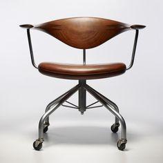 Hans Wegner leather and teak swivel chair