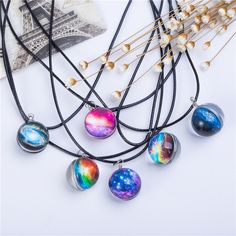 These fascinating galaxy space necklaces have double side pendant which makes it…
