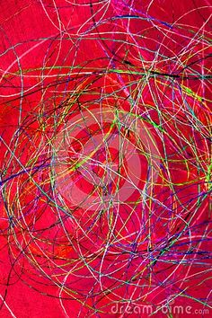 Closeup of metallic threads isolated on a red background.