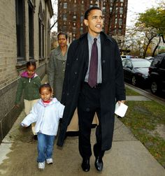 Illinois Democratic U.S. Senate candidate Barack Obama leaves with his wife Michelle, daughters Sasha, front left, and Malia after voting at Catholic Theological union polling place Tuesday, Nov. 2, 2004, in Chicago. (AP Photo/Nam Y. Huh)  via @AOL_Lifestyle Read more: http://www.aol.com/article/news/2016/12/13/michelle-obama-most-popular-quotes-parenting-white-house/21626516/?a_dgi=aolshare_pinterest#fullscreen