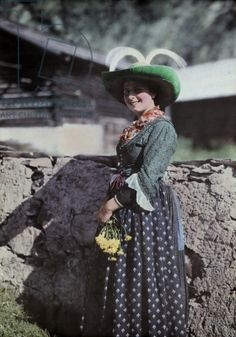 An Otztal woman poses in a traditional costume, Unterlangenfeld, Austria, 1930 (autochrome)