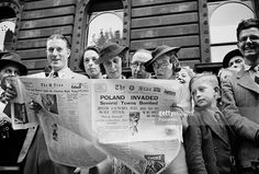 World War Two, London, England, September 3rd 1939, People reading newspapers while waiting outside 10 Downing Street to hear the Declaration of War following the German invasion of Poland