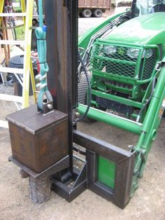 Post Pounder by Spike-MI -- Homemade post pounder constructed from a hydraulic cylinder, controller, hoses, channel, pulleys, cable, and tubing. http://www.homemadetools.net/homemade-post-pounder-2
