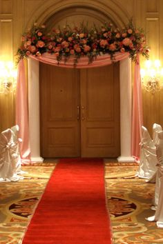 beautiful for arch?!!!!  Do a flower count!   elegant fabric draped wedding entrance
