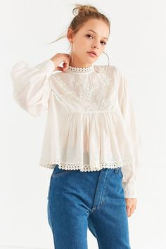 UO Victoria Embroidered Mock-Neck Blouse | Urban Outfitters