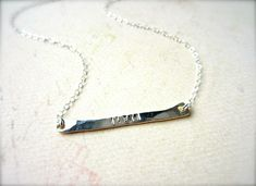 Tiny Custom Bar Necklace on Uncovet.com - A new, original twist on the custom stamped name necklace!
