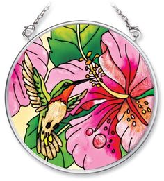 Amia 6137 Hand Painted Glass Suncatcher with Hummingbird Design, 3-1/2-Inch Circle by Amia. $10.00. Handpainted glass. Comes boxed, makes for a great gift. Includes chain. Amia glass is a top selling line of handpainted glass decor. Known for tying in rich colors and excellent designs, Amia has a full line of handpainted glass pieces to satisfy your decor needs. Items in the line range from suncatchers, window decor panels, vases, votives and much more.