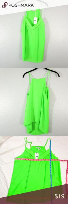 Naked Zebra Neon Green Spaghetti Strap Cami Naked Zebra Neon Green Spaghetti Strap Cami Size Large 100% Polyester NWT - New with tags Please see photo for measurements Naked Zebra Tops Camisoles