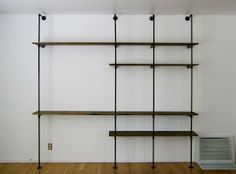 bookshelves with piping and reclaimed wood - good tutorial on this link