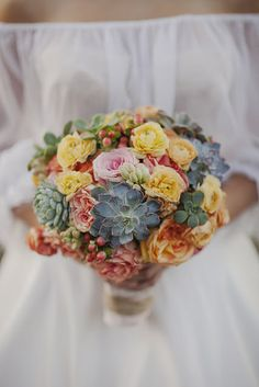@Donna Gierman  A pretty bouquet that would tie in with your boots. Maybe should be a bit smaller. *Go to the site. Colors are more vivid and it's a whole Spanish wedding photo shoot. Bright & happy!