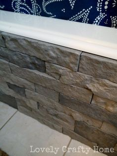 Airstone! It's faux stone that's easy to work with and 80% recycled. She used it to cover an ugly bathtub, but you can use it other places, too.