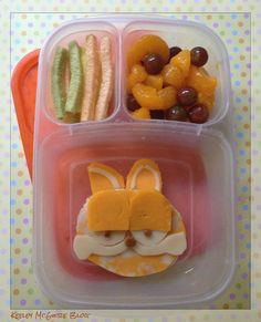 Nice to see faces made of cheese and not bread.  ...Garfield the Cat bento lunch