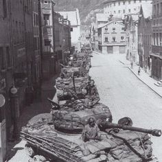 A column of M4A3 (76mm) with HVSS, Sherman tanks of 25th Tank Battalion, 14th Armored Division clank through the streets of Eichstätt, Bavaria on 25 April 1945.