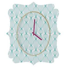 """Quatrefoil-shaped clock with a geometric motif from DENY Designs. Made in the USA.  Product: ClockConstruction Material: Wood and aluminumColor: MultiFeatures:  Designed by Gabi Lanterns for DENY DesignMade in the USA Accommodates: Batteries - not includedDimensions: Small: 19.5"""" H x 14.5"""" W x 0.75"""" DMedium: 29.2"""" H x 21.7"""" W x 0.75"""" DLarge: 36"""" H x 30.6"""" W x 0.75"""" DCleaning and Care: Spot clean with window cleaner"""