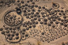 Cemeteries and camps of Afari nomads sit amidst lava flows partially buried in clay near the Awash River Delta in Ethiopia.