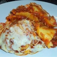 Randy's Slow Cooker Ravioli Lasagna - fantastic way to enjoy lasagna without all the fuss! I thought using frozen ravioli already filled with cheese instead of layering layers of noodles and cheese would make a great dish so easy. It all comes together; just scoop it out, serve with a salad, and enjoy