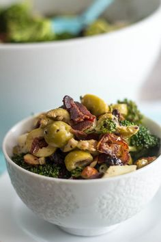 Broccoli, Almonds, Apple, Green Olives, Dates and Bacon unite with a creamy, zesty vinaigrette to create a deliciously addictive and nutritious salad.