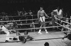 Referee Zack Clayton counts out Foreman in round eight of the title bout, after Ali's 'rope-a-dope' tactics had worn the young champion out.