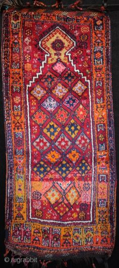 Dazzling Kurdish Drejan Tribe woman's prayer rug from eastern Anatolia between Gaziantep and Malatya. Lustrous wool on a goat hair warp with top and bottom çiçim embroidered kilim guards and bound tassels. Natural dyes, including the orange, a particular feature of Kurdish rugs from this area. Size 170cm x 70cm. From the 1920s in excellent condition with just one nomadic repair to the lower left selvage edge.