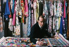 Emilio Pucci at Work. Photo taken in 1959, Florence, Italy — The legendary fashion designer, Emilio Pucci, with examples of his work.