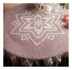 This is another tablecloth I made in the past few months.  This picture shows white but I made it in Ecru (Beige).