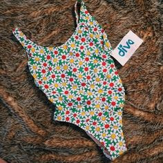 vintage one piece swimsuit be a 70s / 80s babe in this brand new one piece swimsuit! all over daisy design. super high cut & slightly cheeky. vintage size 10, fits like a small. or a smaller medium. Swim One Pieces
