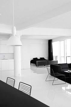 Stay hotel in Copenhagen by Atelier XL. Nice clean all-white interior with black furniture for contrast.