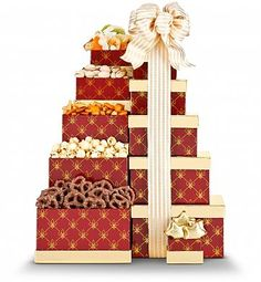 Tempting Treats Gift Tower     Take a look at this tempting tower of treats. We've created this special Tempting Treats Gift Tower  to include delicious snacks that will satisfy any snacker with just a hint of sweetness and lots of goodness. $49.99    http://www.littlegiftbasketboutique.com/item_1026/Tempting-Treats-Gift-Tower.htm
