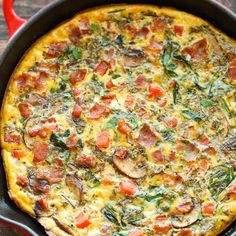 Bacon Mushroom Spinach Frittata Recipe Breakfast and Brunch with large eggs, milk, dried basil, dried oregano, dried thyme, hot sauce, kosher salt, ground black pepper, bacon, garlic, cremini mushrooms, baby spinach, roma tomatoes