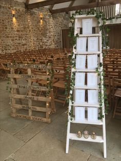 """We love this idea which incorporates a ladder with the table plan, ivy and a wooden palate for the """"Order of the Day"""""""